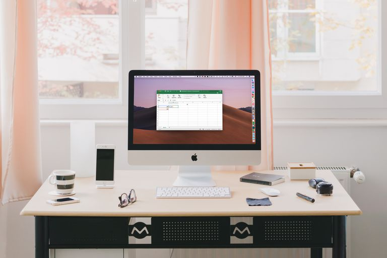 Excel on iMac screen in home office