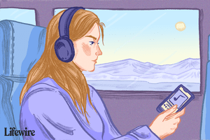 Person listening to music from a smartphone via Bluetooth headphones