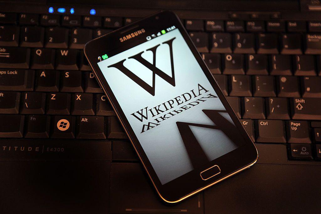 Wikipedia logo on a phone on a keyboard