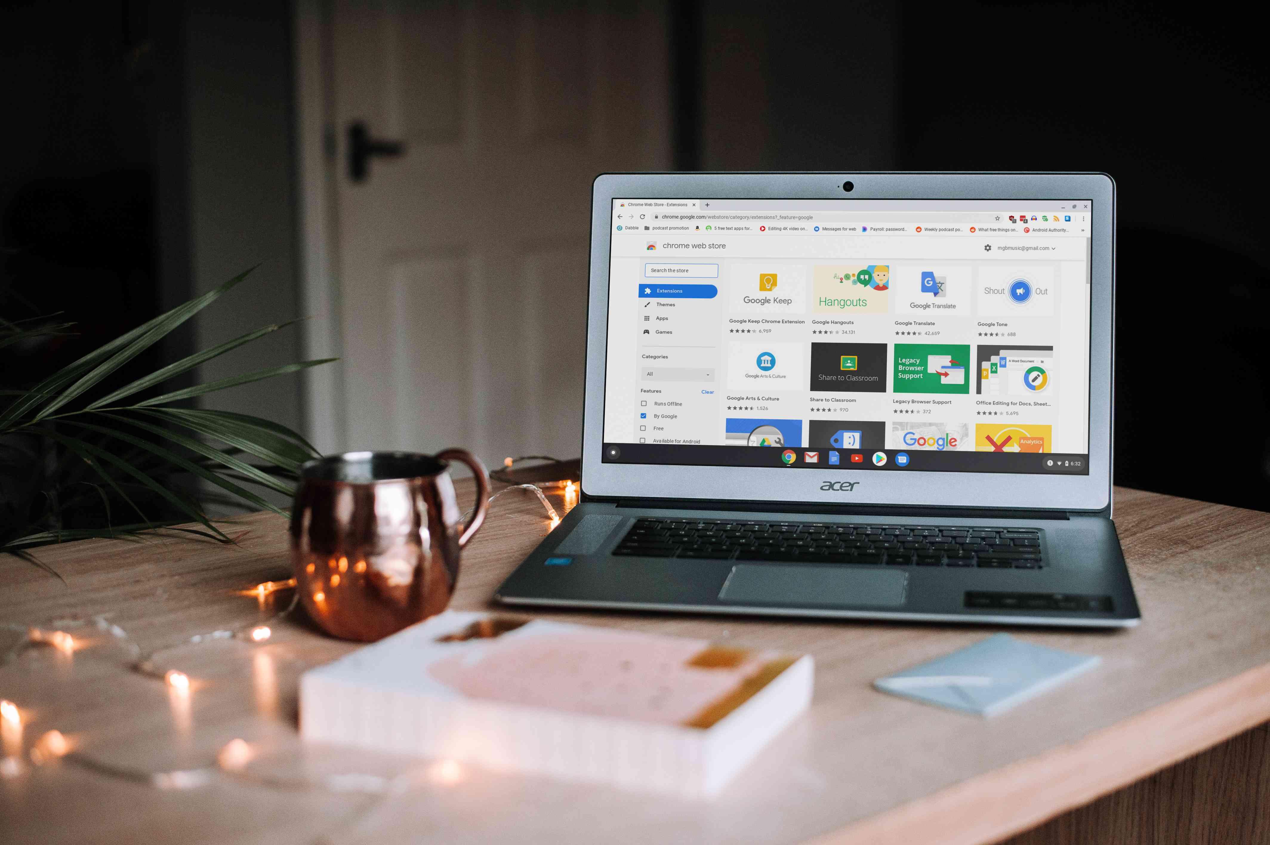 Chromebook on a table with a mug
