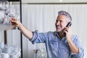 Man using wireless home phone
