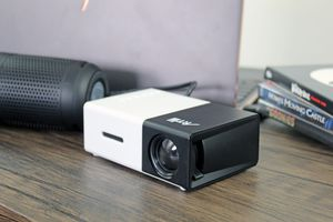 A projector with a connected speaker.