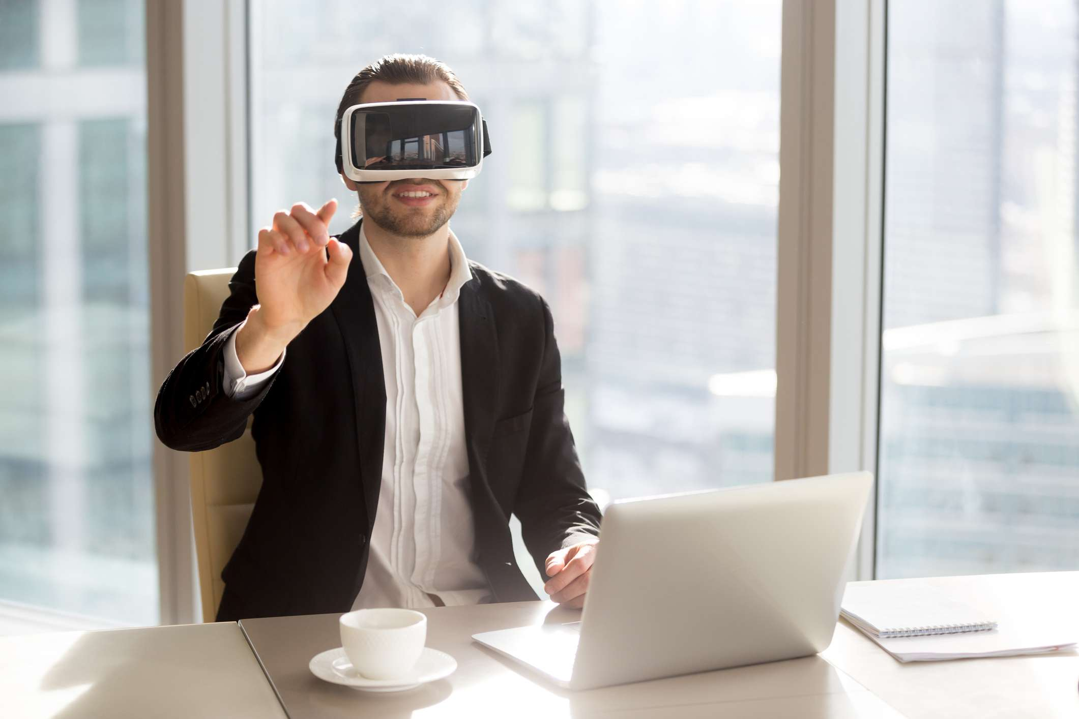 Man in VR headset touching virtual objects