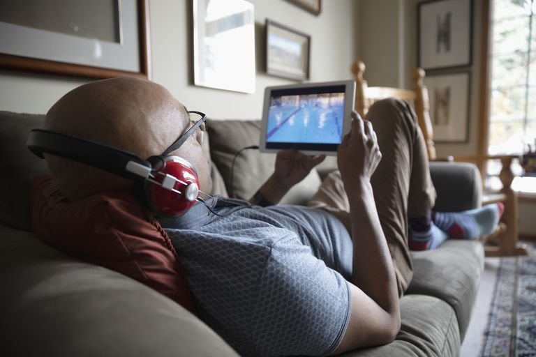 Man watching sports video on a tablet