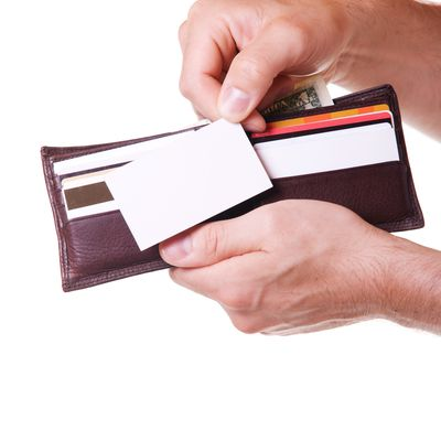 Learn the correct size for a standard business card hand putting business card in wallet reheart Image collections