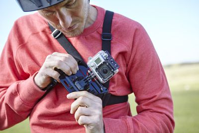 Man attaching GoPro to chest
