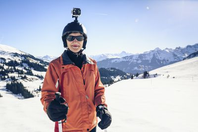 A skier wearing a GoPro on their helmet