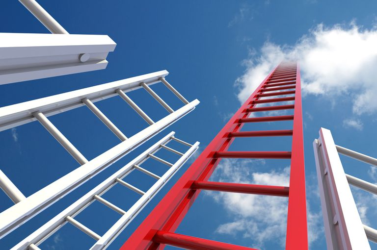 Ladders reaching to the sky with one being red