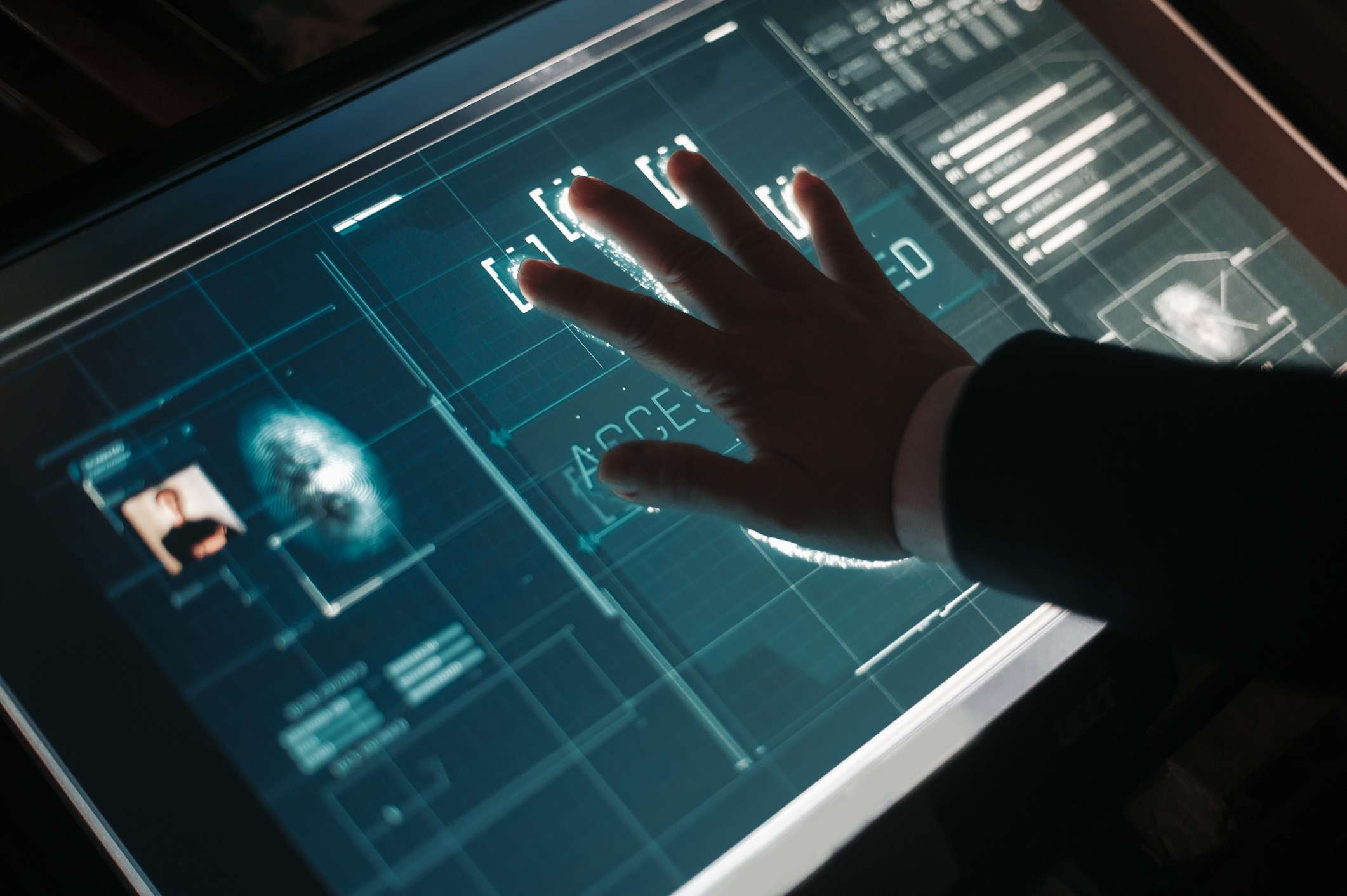 Someone's palm being scanned by a biometric scanner.