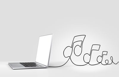 Laptop computer with cable forming musical notes