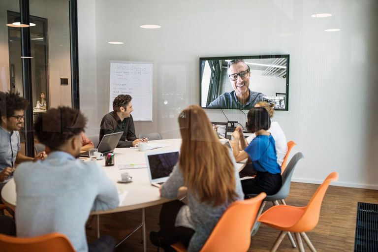 Team video conferencing with remote workers in an office