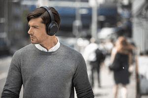 Man wearing Sony WH1000XM3 headphones