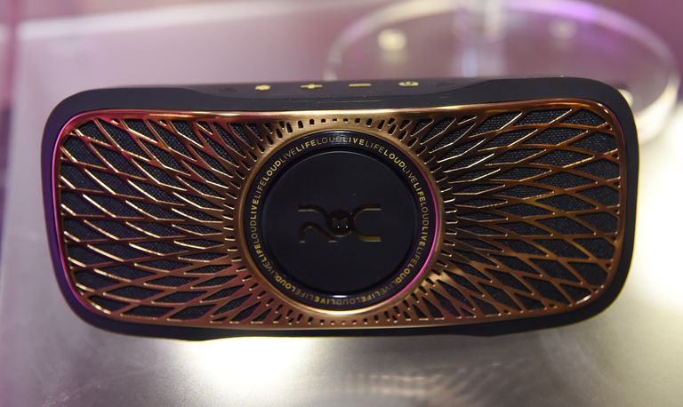 A gold and black speaker