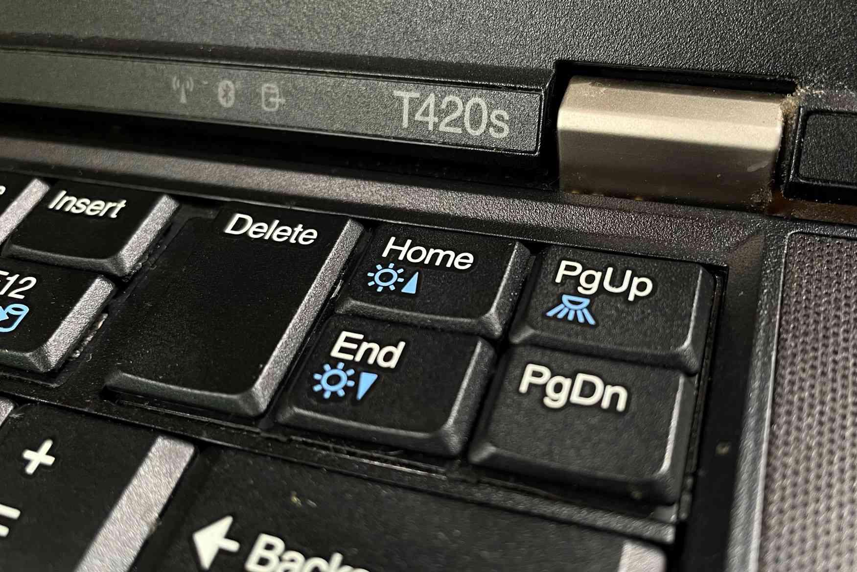 A photo of the Lenovo ThinkLight button on a Lenovo ThinkPad T420s