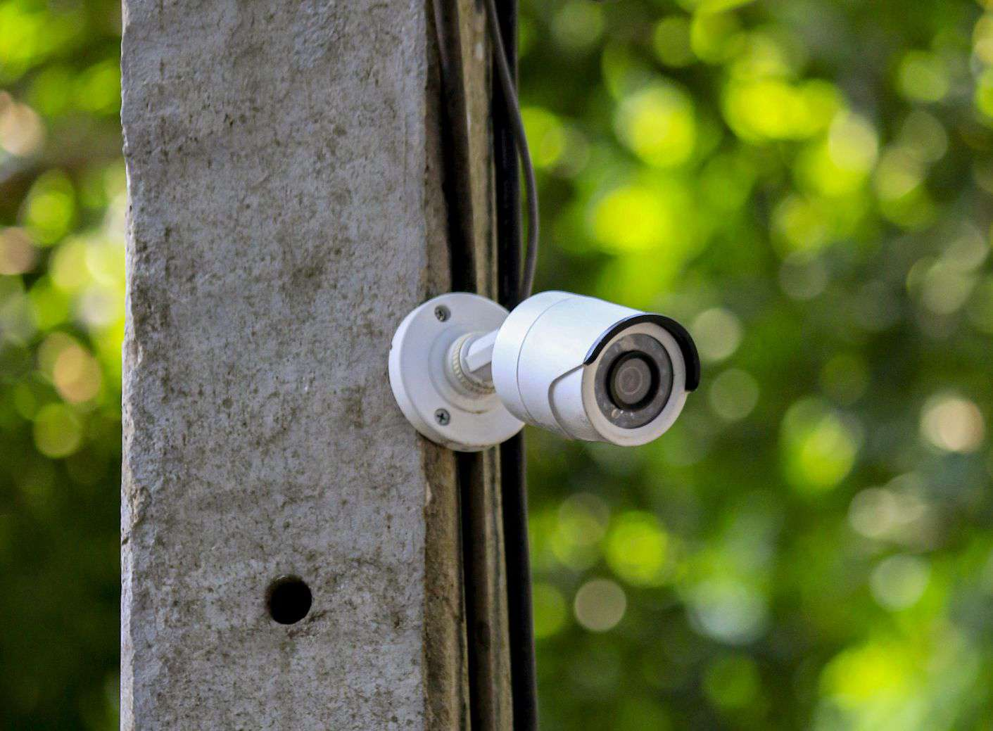 Image of outdoor security camera near wires