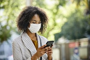 Person wearing mask on phone