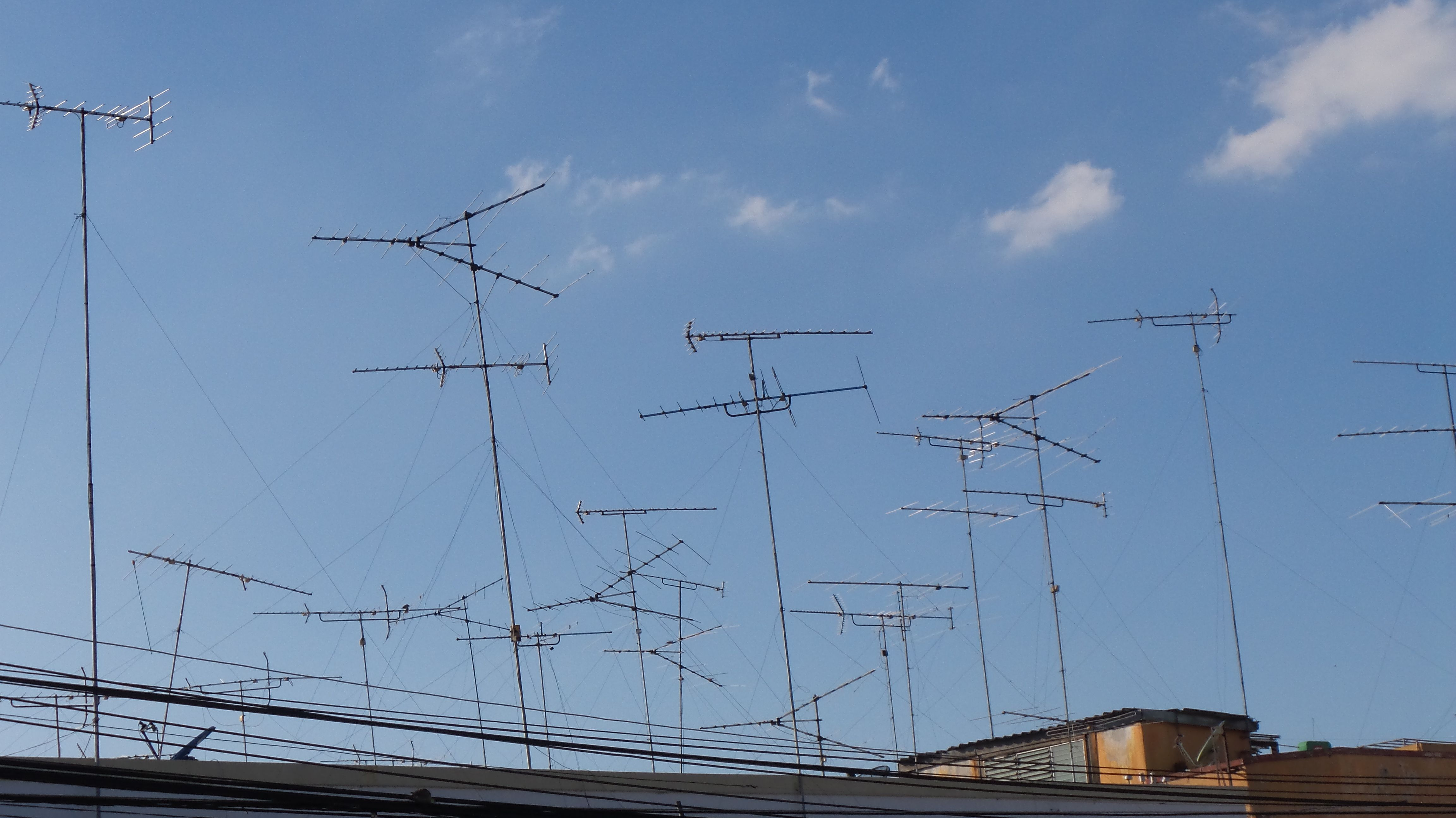 Low Angle View Of Television Aerials Against Sky