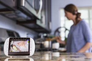 Baby monitor being used in a kitchen