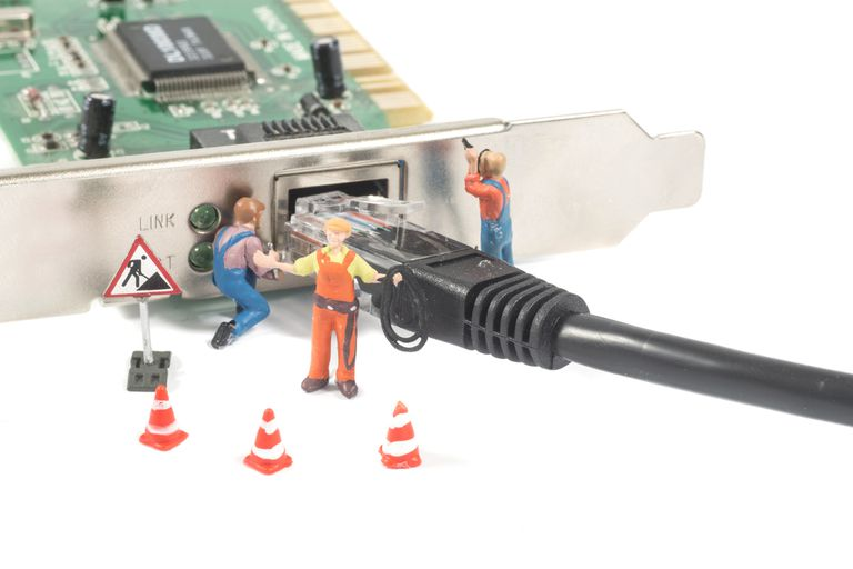 Small characters plugging an ethernet cable into a network card.