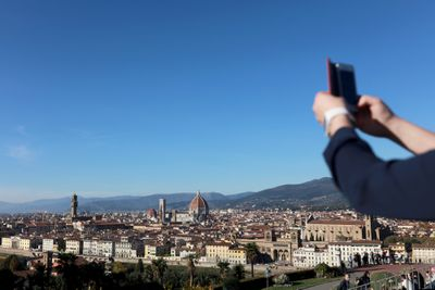 Person taking a panorama photo.