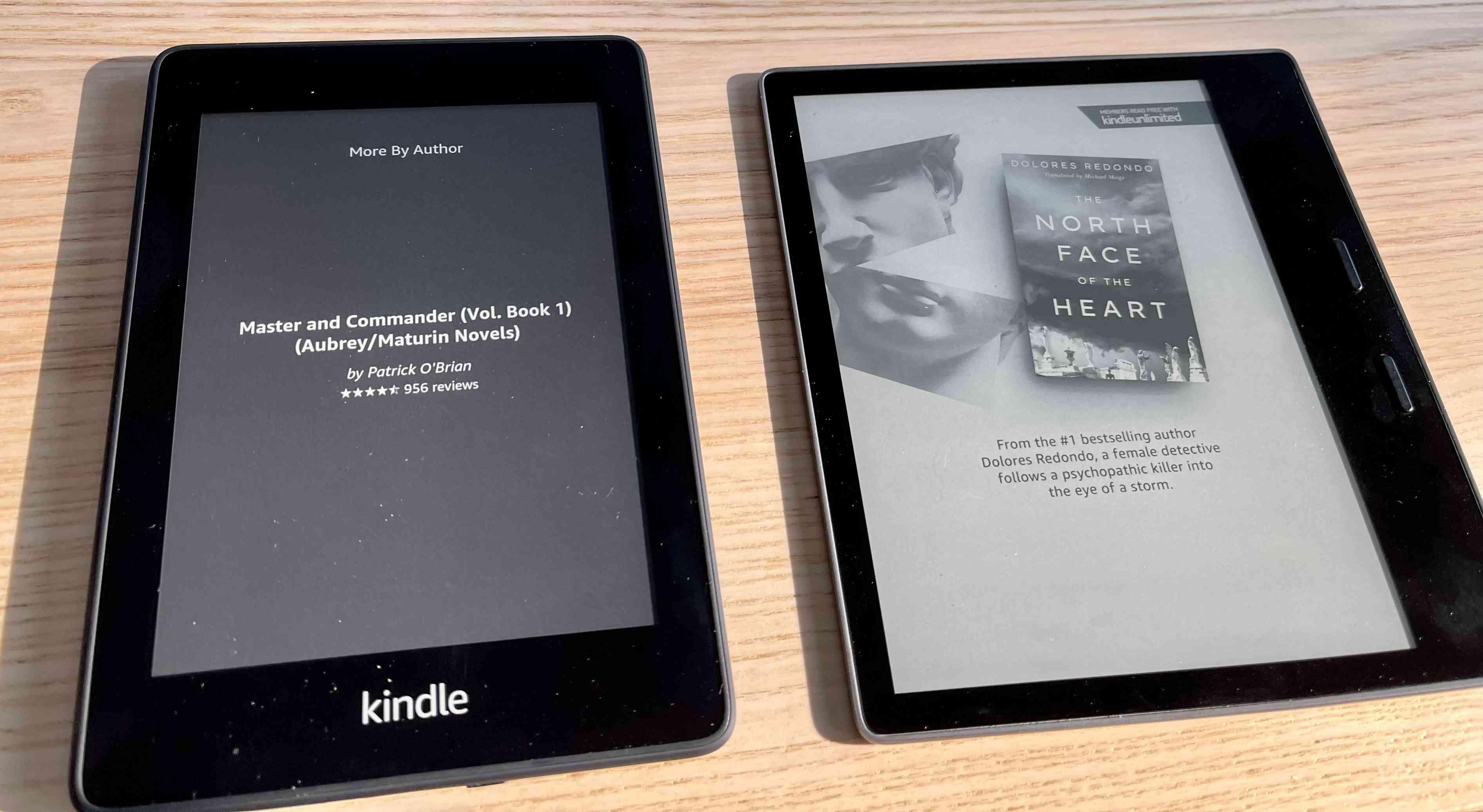 A Kindle e-reader next to a Kindle Oasis e-reader.