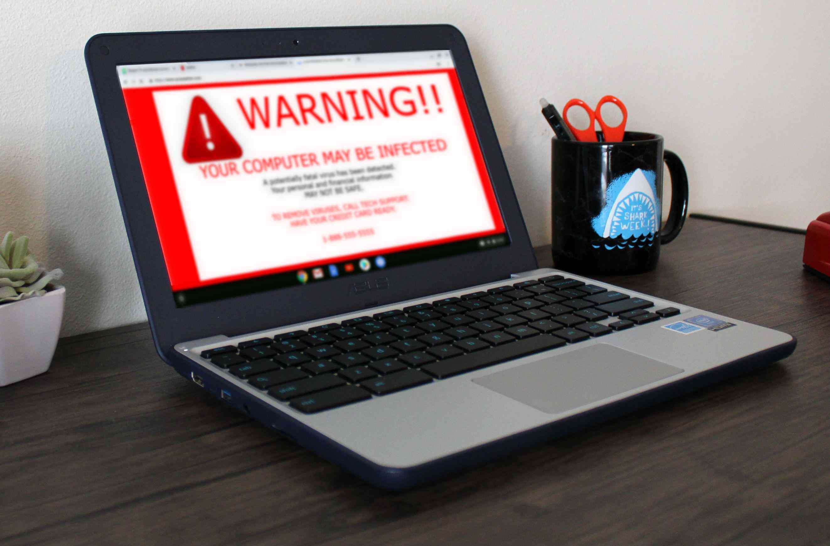 A fake virus warning displayed on a Chromebook.