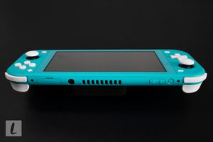 A Nintendo Switch Lite games console on a black background