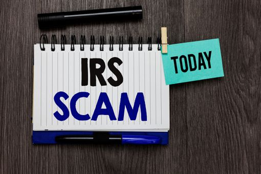 IRS SCAM written on a notepad.