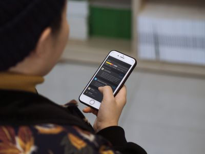 A woman using an iPhone.