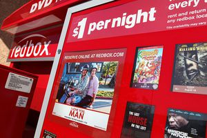 Movie titles are displayed on a RedBox video rental kiosk