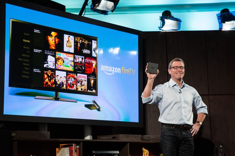 Amazon's vice president displaying the Amazon Fire TV