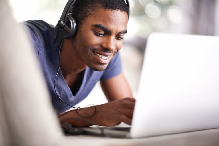 A man with headphones listening to free online music