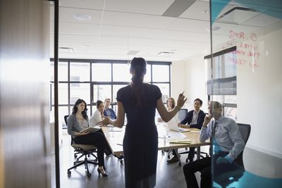 Business owner leading a meeting in a conference room