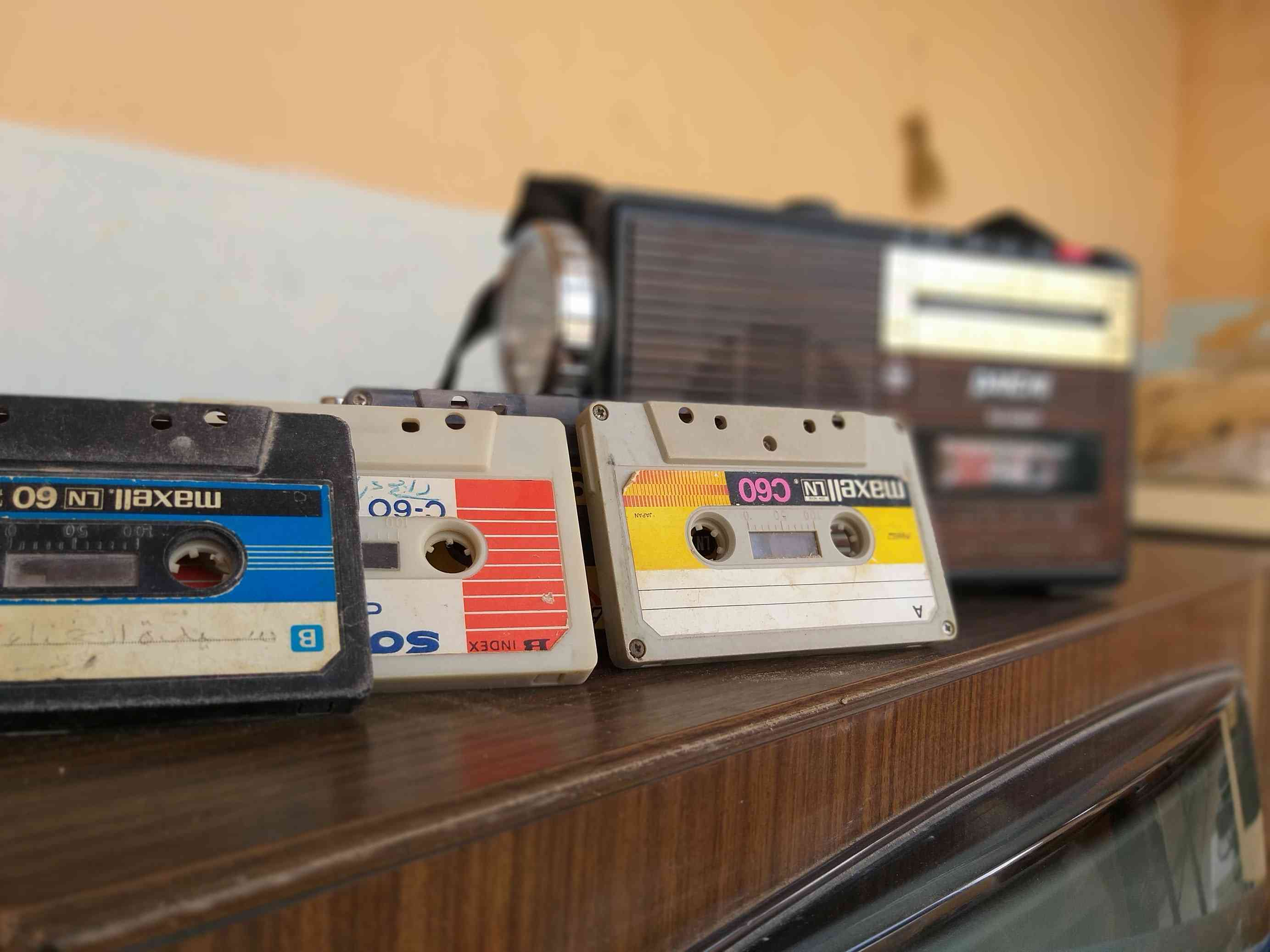 cassette tapes and radio on wooden table