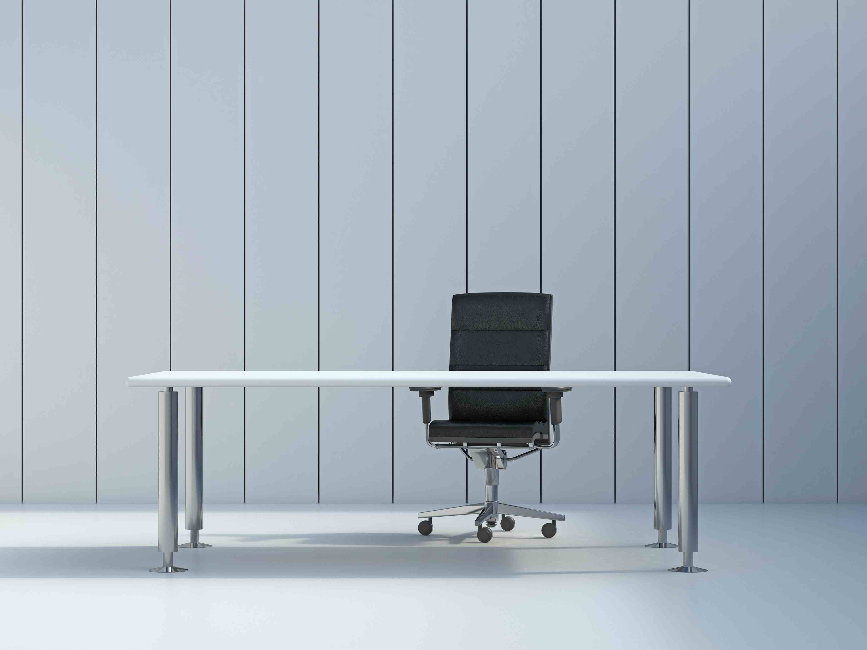 Office chair and conference table in front of grey wall panel, 3D Rendering