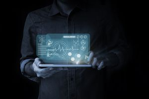 Man points to health data