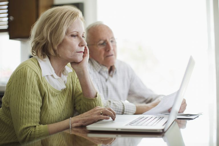 Senior man and woman using computer