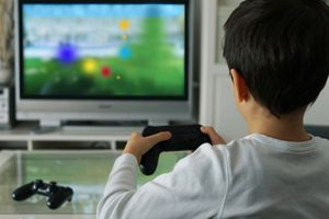 Little boy playing a video game