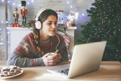Woman listening to Christmas music with headphones