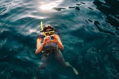 woman snorkeling with gopro
