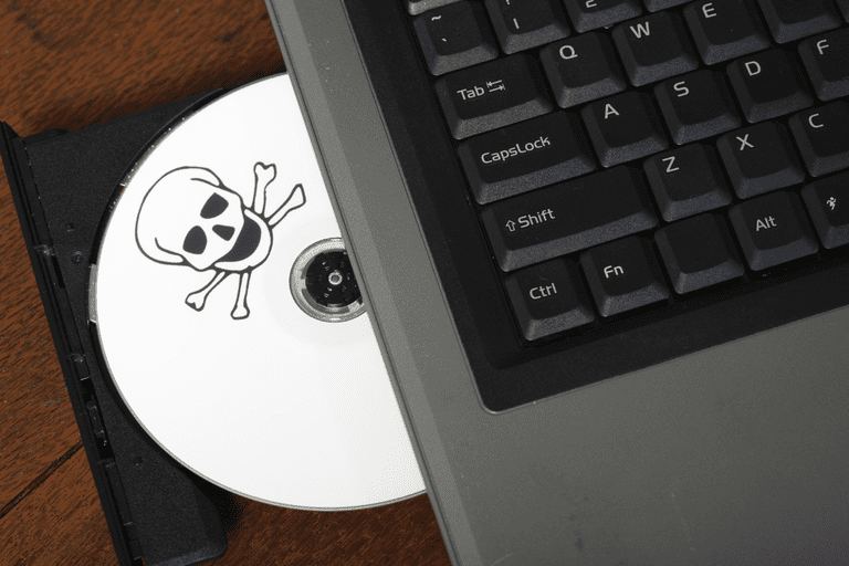 An image of a pirated CD in a computer disk drive