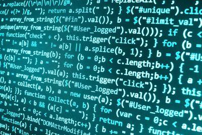 Software developer programming code on computer