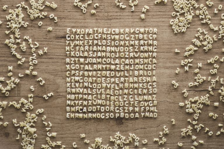 Letters on a wooden table arranged into a grid