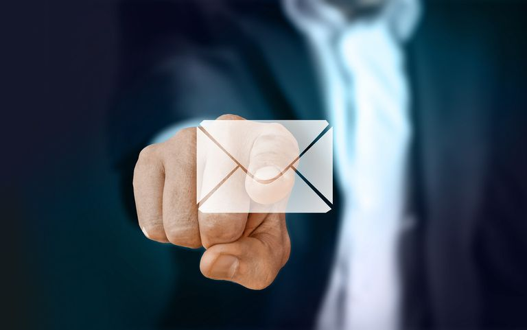 Businessman pointing to an envelope icon