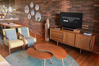 An LG TV in a living room displaying Netflix error code UI-800-2.