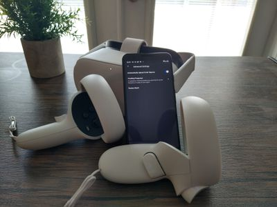 Factory resetting an Oculus Quest headset using a phone.