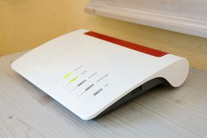 White router on tabletop in a home