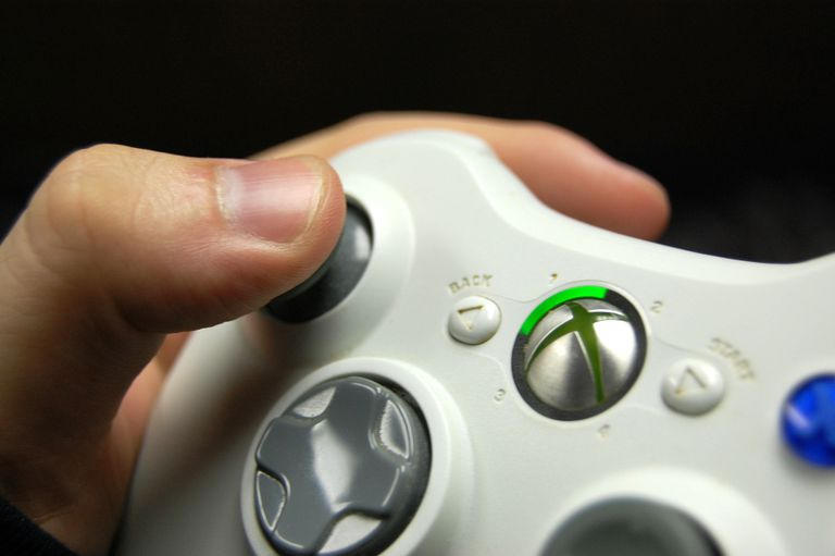 Close up Xbox live controller with hand on it