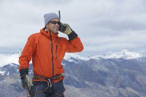 Hiker using handheld CB radio