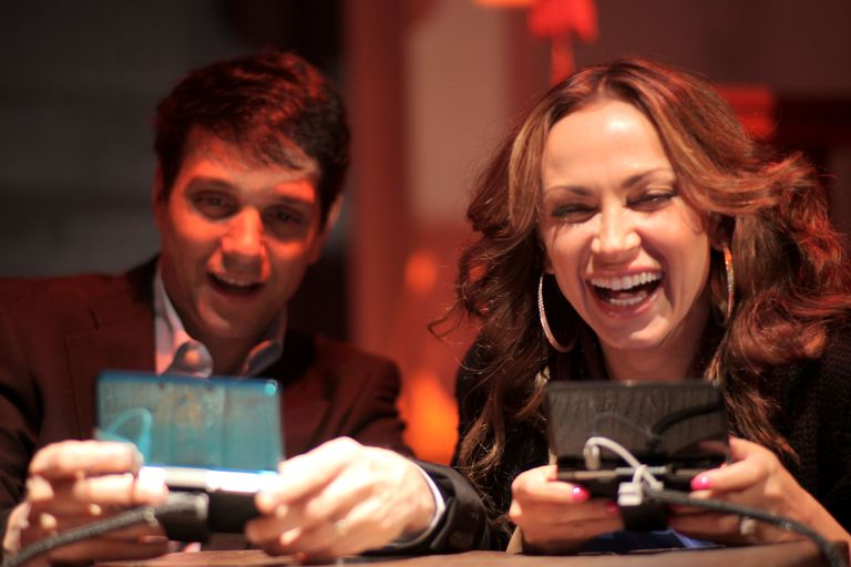 Actor Ralph Macchio and TV personality Karina Smirnoff play Nintendo 3DS